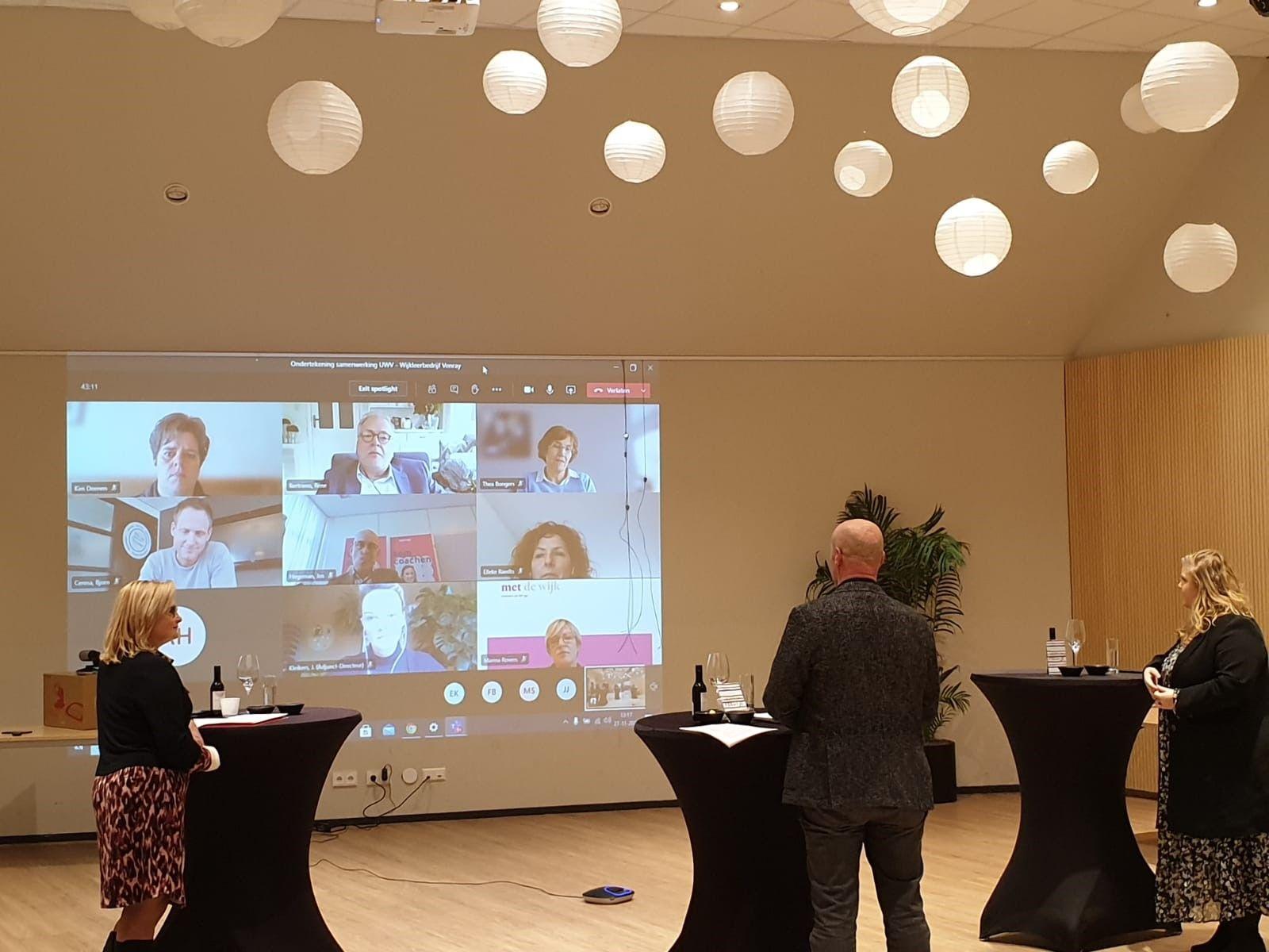 Tijdens een digitale bijeenkomst wordt het ondertekenen van het samenwerkingsconvenant gevierd